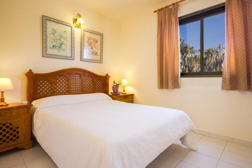 A bed or beds in a room at Sands Beach Resort
