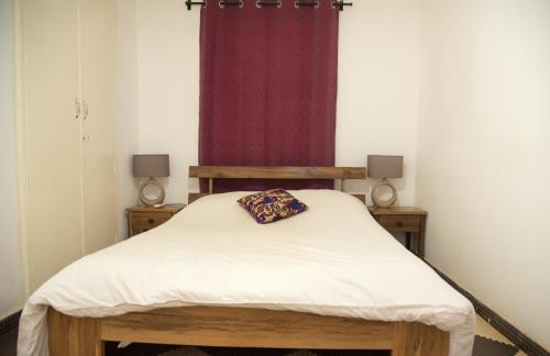 A bed or beds in a room at Umoja Guesthouse II