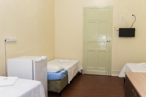 A bed or beds in a room at Hotel Palácio - Próx ao Hospital Santa Casa
