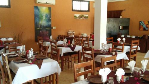 A restaurant or other place to eat at Le Grand Calao