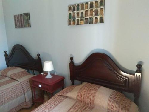 A bed or beds in a room at Casa Maria Victoria