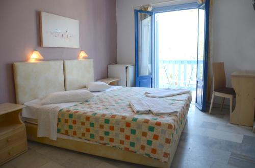 Łóżko lub łóżka w pokoju w obiekcie Hotel Argo