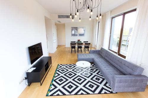 Telewizja i/lub zestaw kina domowego w obiekcie Komfortowy apartament Międzyzdroje