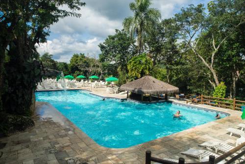 A piscina localizada em Ecoresort Refúgio Cheiro de Mato ou nos arredores