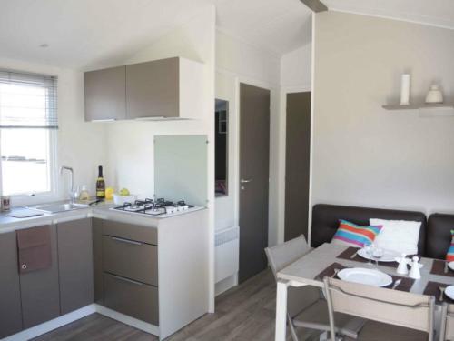 A kitchen or kitchenette at Camping de la Bonnette