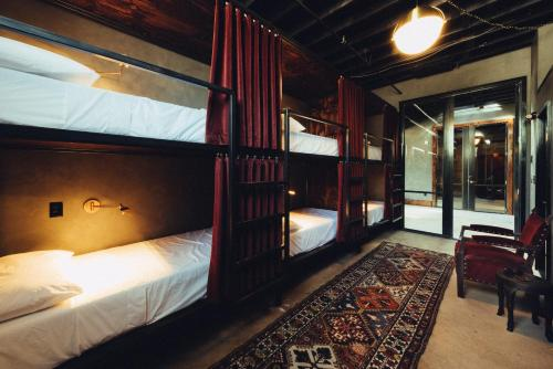 A bunk bed or bunk beds in a room at Native Hostels Austin