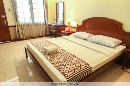 Кровать или кровати в номере Duta Guest House