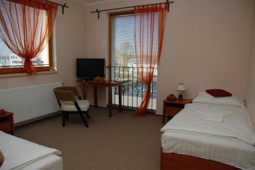 Кровать или кровати в номере Hotel & restaurant SIGNAL
