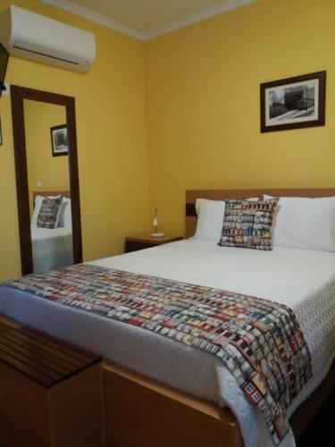 A bed or beds in a room at B&B Pensão Avenida