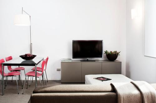 A television and/or entertainment center at Zambala Luxury Residence