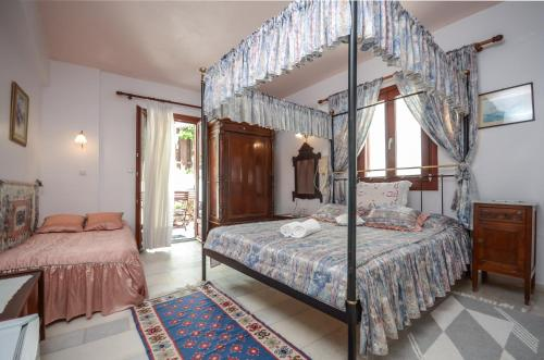 A bed or beds in a room at Chateau Zevgoli