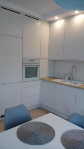Kuchnia lub aneks kuchenny w obiekcie Apartament z widokiem na Jezioro