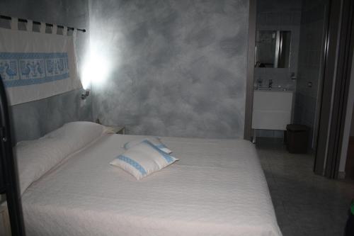 Letto o letti in una camera di La Pavoncella