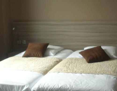 Un ou plusieurs lits dans un hébergement de l'établissement Auberge du Vieux Chateau