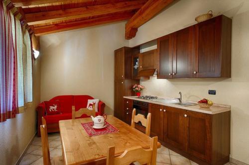 Cuisine ou kitchenette dans l'établissement Appartamenti Godioz