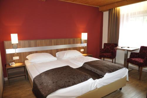 Een bed of bedden in een kamer bij Hotel-Landgasthof Katschtalerhof