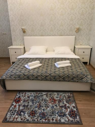 A bed or beds in a room at Hotel Compas