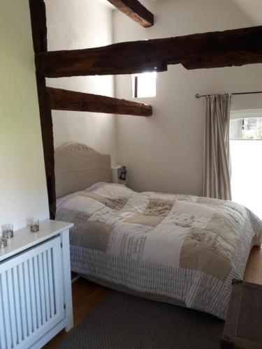 Ein Bett oder Betten in einem Zimmer der Unterkunft Hofgut Bockelkathen