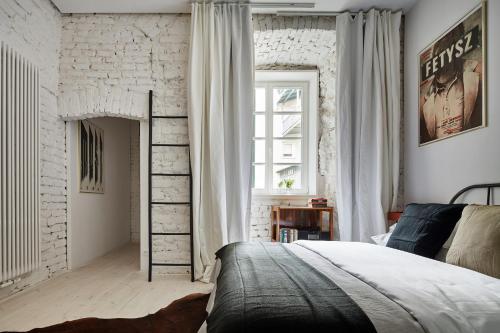 Łóżko lub łóżka w pokoju w obiekcie OLD NEW - Szczepanska