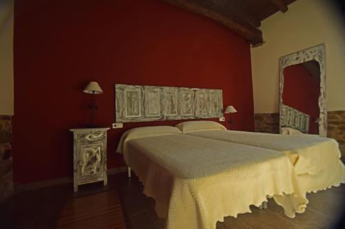 A bed or beds in a room at Molinos de Antero