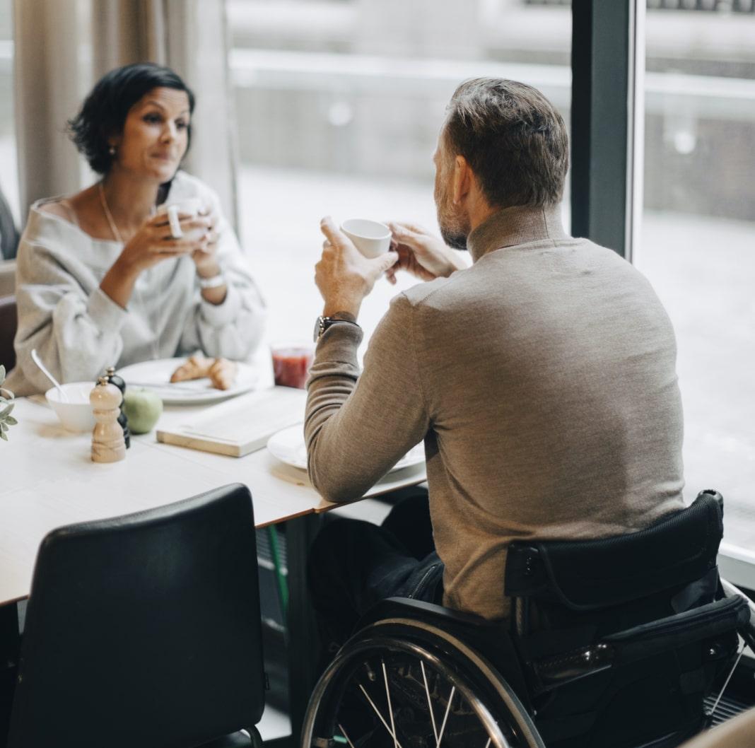 Couple enjoying a coffee during their trip