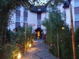 Na fali Pokoje Goscinne – hotel w pobliżu miejsca Łeba Park w Łebie