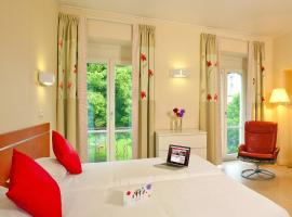 Hotels & Résidences - Les Thermes, apartment in Luxeuil-les-Bains