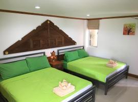 Taosha Suites Hotel، فندق في شاطئ كامالا