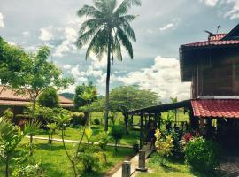 Soluna Guest House, vacation rental in Pantai Cenang