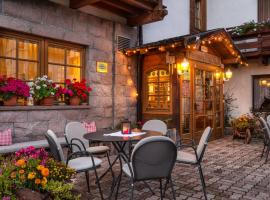 Romantic Charming Hotel Rancolin, hotel in Moena