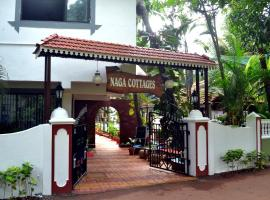 Naga Cottages, hotel with pools in Morjim