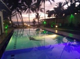 Hotel Ocean View Cottage, отель в Хиккадуве