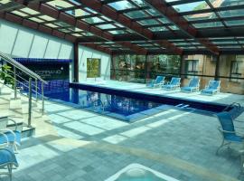 Flat Prodigy Serrano Hotel, serviced apartment in Gramado