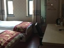 JUNYI Hotel Shandong Jinan Zhangqing District Daxue Road, отель в Цзинане