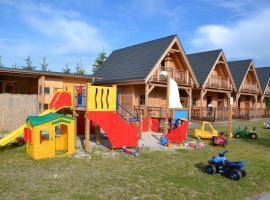 Domki Zacisze Leby – hotel w pobliżu miejsca Park Dinozaurów Łeba w Łebie