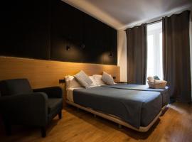 CC Malasaña, habitación en casa particular en Madrid