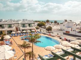 Hotel Pocillos Playa, отель в городе Пуэрто-дель-Кармен