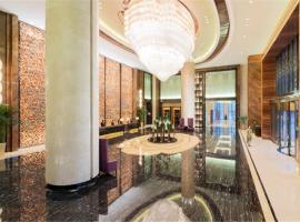 Wanda Realm Jining, отель в городе Jining
