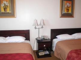 Travel Inn & Suites, hotel em Innisfail