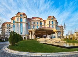 Wanda Realm Qingdao Movie Metropolis, отель в городе Huangdao