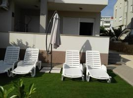 Malik's place, self catering accommodation in Novalja