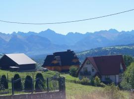 """Apartamenty i pokoje rodzinne – hotel w pobliżu miejsca Wyciągi narciarskie """"Koziniec"""" w Czarnej Górze"""