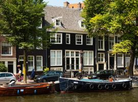 Canal Wow Suites Amsterdam, B&B in Amsterdam