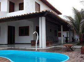 Casa de Praia com Piscina, hotel with pools in Luis Correia