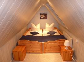 romantisches Ferienhaus Boddenblick mit Sauna, apartment in Pruchten