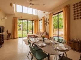 Greenwoods One by Vista Rooms, villa in Lonavala