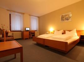 Hotel Weisse Taube, отель в городе Ашерслебен