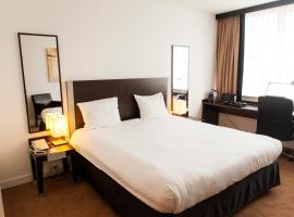 Progress Hotel, hotel Brüsszelben