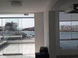 Cozy & elegant apartment with a stunning view to sea, beach hotel in San Bartolo