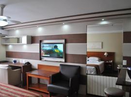 Flat em Hotel 4 estrelas Ed Alpenhaus Gramado-4 pessoas, serviced apartment in Gramado